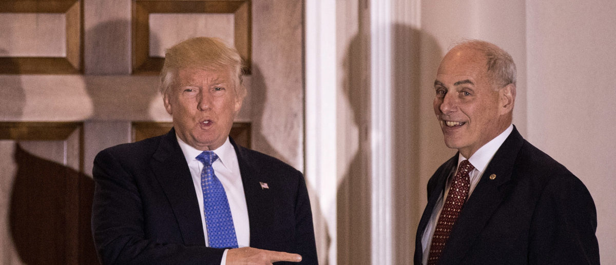 President-elect Donald Trump points at U.S. Marine Corps General John Kelly before their meeting at Trump International Golf Club, November 20, 2016 in Bedminster, New Jersey. Photo by Drew Angerer/Getty Images