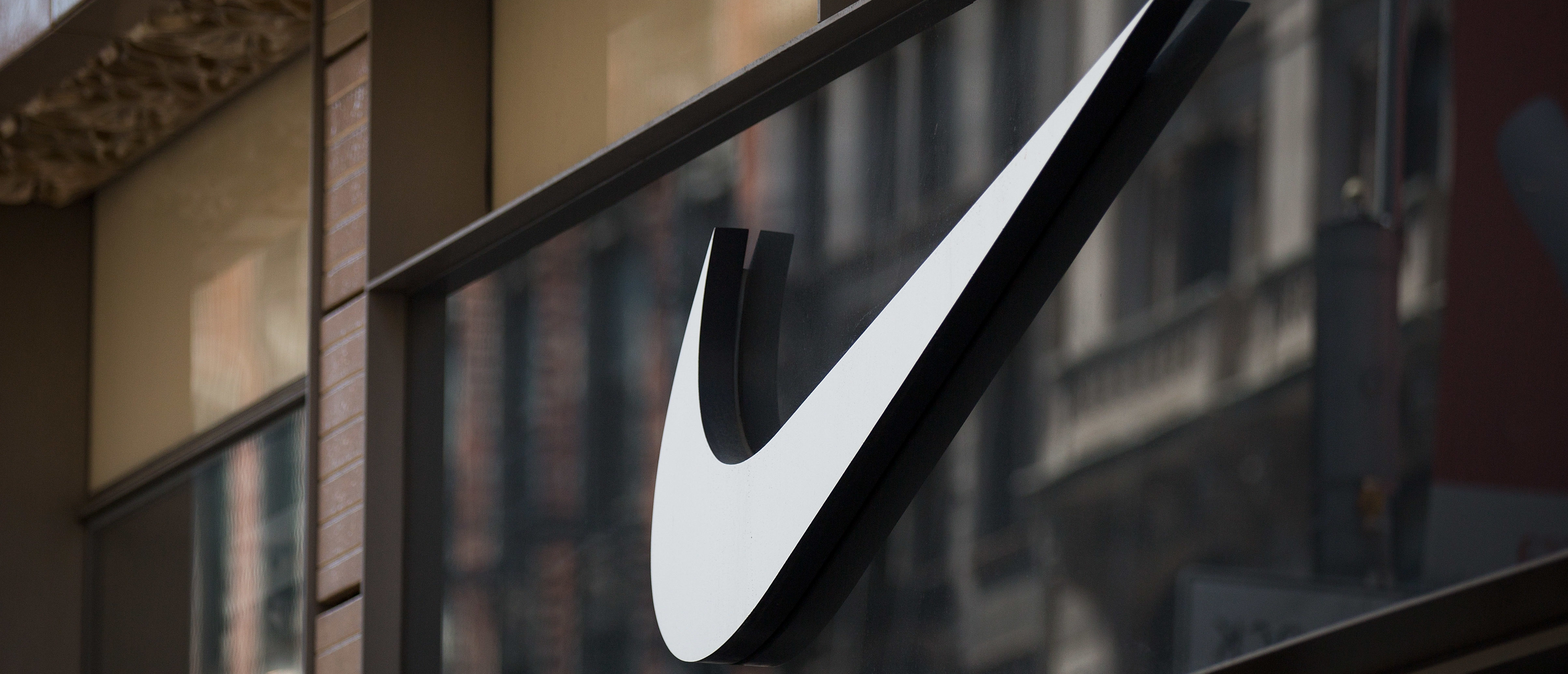 NEW YORK, NY - JUNE 15: The Nike 'swoosh' logo is displayed on the outside of the Nike SoHo store, June 15, 2017 in New York City. Nike announced plans on Thursday to cut about 2 percent of its global workforce. (Photo by Drew Angerer/Getty Images)