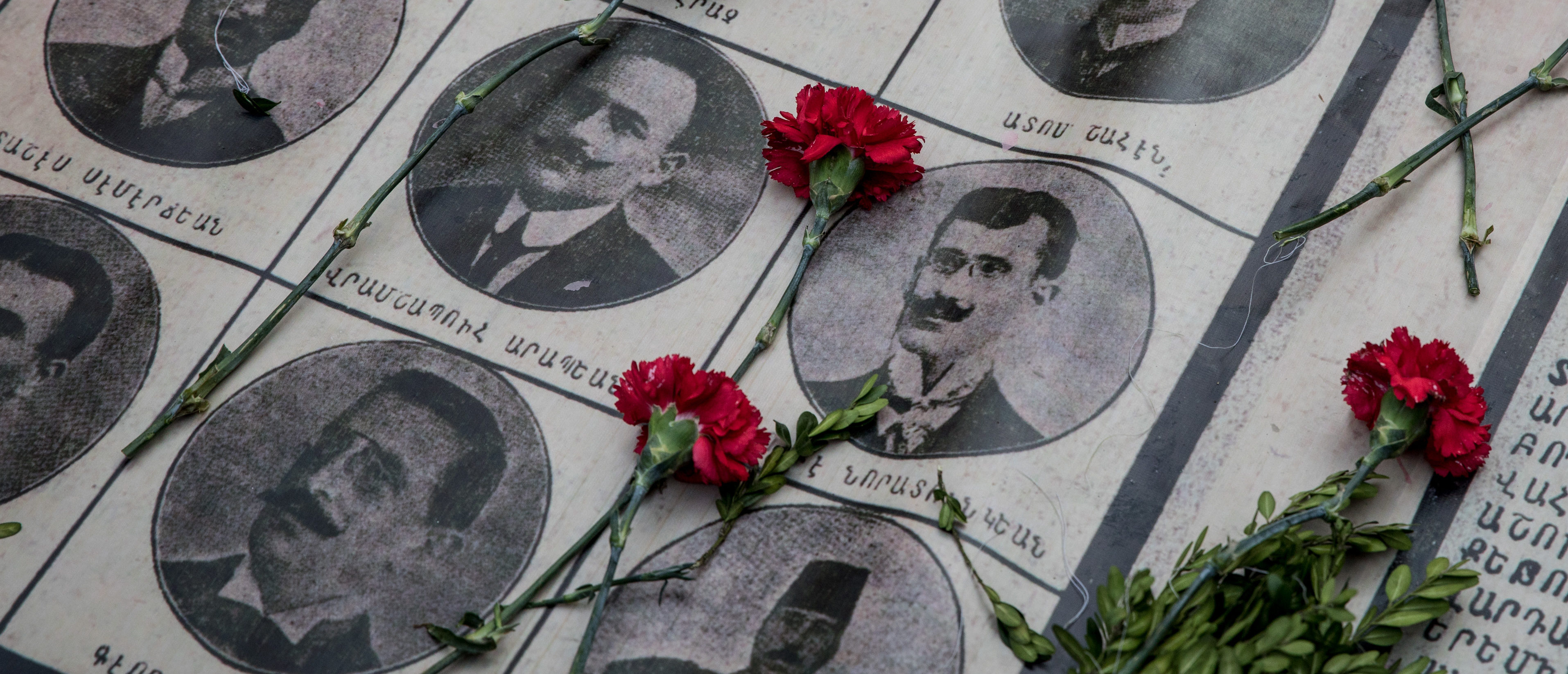 ISTANBUL, TURKEY - APRIL 24: Roses are seen on the portraits of victims during a memorial to commemorate the 1915 Armenian mass killings on April 24, 2018 in Istanbul, Turkey. People gathered to mark the 103rd anniversary of the slaughter of up to 1.5million Armenians by the Ottoman government in an event many view as genocide. (Photo by Chris McGrath/Getty Images)