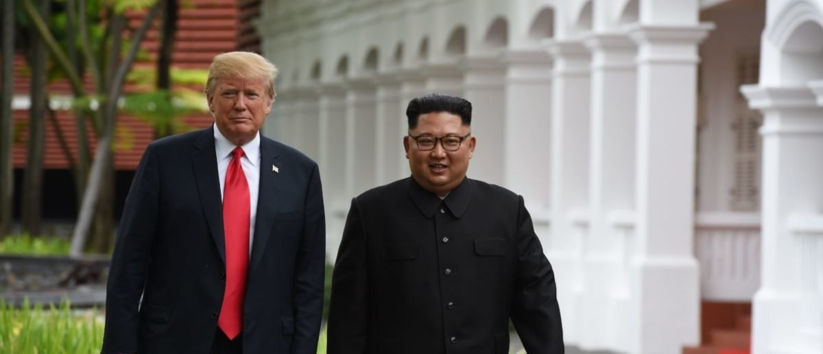 North Korea's leader Kim Jong Un (R) walks with US President Donald Trump (L) during a break in talks at their historic US-North Korea summit, at the Capella Hotel on Sentosa island in Singapore on June 12, 2018. - Donald Trump and Kim Jong Un became on June 12 the first sitting US and North Korean leaders to meet, shake hands and negotiate to end a decades-old nuclear stand-off. (Photo by Anthony WALLACE / POOL / AFP) (Photo credit should read ANTHONY WALLACE/AFP/Getty Images)