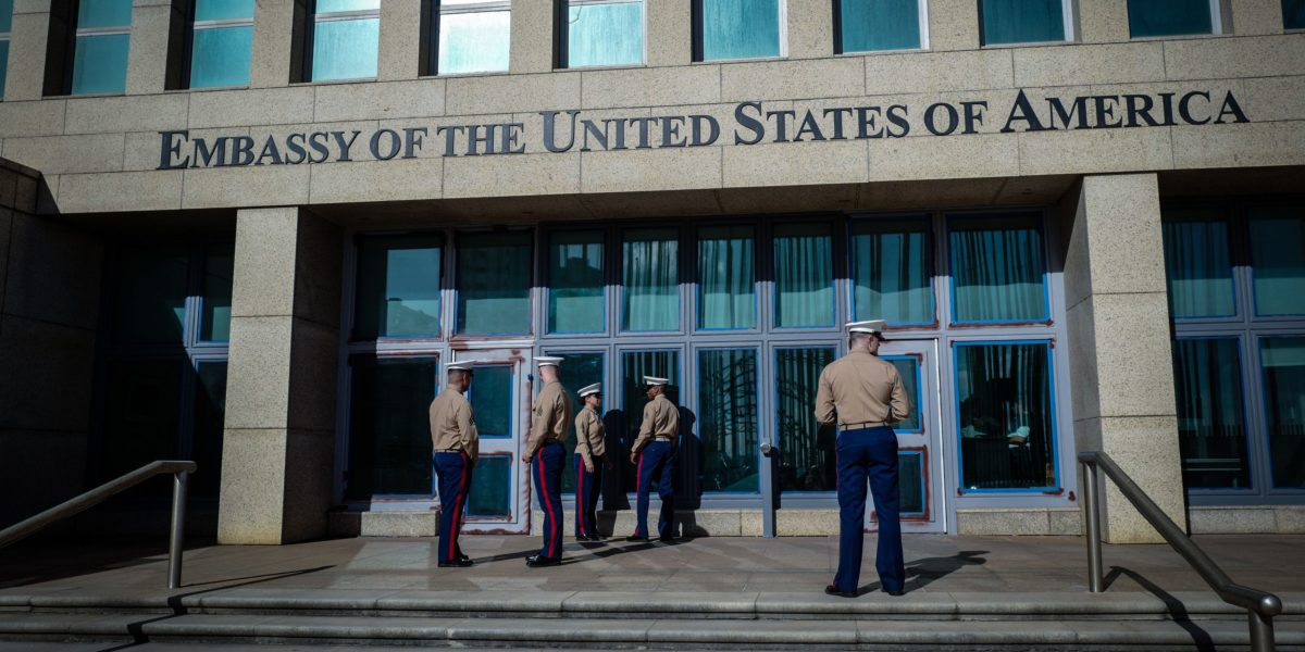 US Marines stand outside the Embassy of the United State of America in Havana, on February 21, 2018. / AFP PHOTO / ADALBERTO ROQUE (Photo credit should read ADALBERTO ROQUE/AFP/Getty Images)