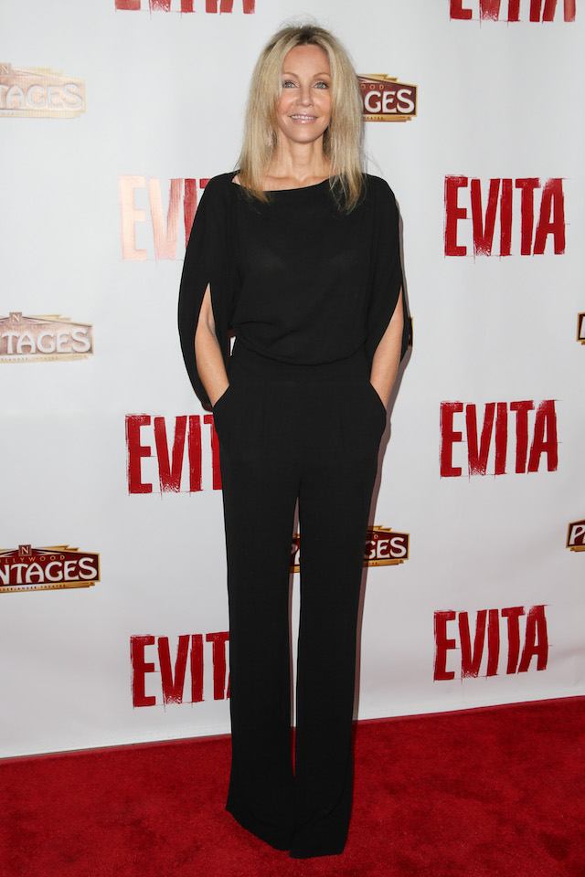 "Actress Heather Locklear arrives at the opening night red carpet for ""Evita"" at the Pantages Theatre on October 24, 2013 in Hollywood, California. (Photo by Chelsea Lauren/Getty Images for The Pantages Theatre)"