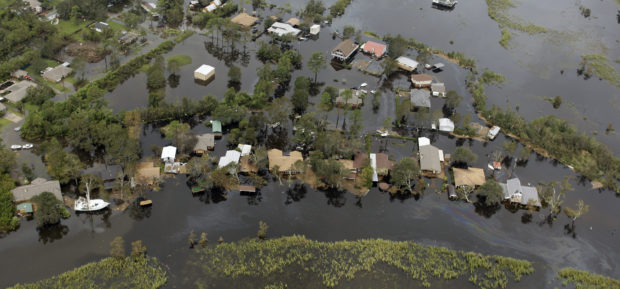 Floodwaters from Hurricane Ike surround homes in Bridge City, Texas, September 14, 2008. REUTERS/David J. Phillip/Pool