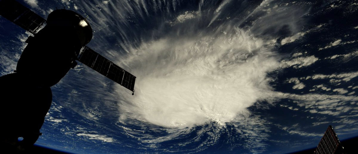 A photo taken from the International Space Station by astronaut Ricky Arnold shows Hurricane Florence over the Atlantic Ocean in the early morning hours of September 6, 2018. Picture taken September 6, 2018. Courtesy @astro_ricky/NASA/Handout via REUTERS ATTENTION EDITORS - THIS IMAGE HAS BEEN SUPPLIED BY A THIRD PARTY. MANDATORY CREDIT. - RC153158FA10