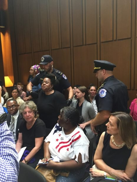 A demonstrator is removed from Judge Kavanaugh's confirmation hearing. (Kevin Daley/Daily Caller News Foundation)