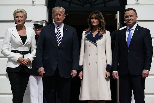 U.S. President Donald Trump (2nd L) and first lady Melania Trump (3rd L) welcome President Andrzej Sebastian Duda (R) of Poland and his wife Agata Kornhauser-Duda (L) during their arrival at the South Portico of the White House September 18, 2018 in Washington, DC. While Trump made Poland the first stop on his European tour last year, Duda is on his first trip to the White House. (Photo by Alex Wong/Getty Images)