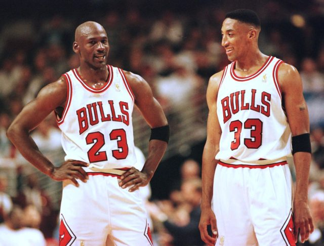 CHICAGO, UNITED STATES: Michael Jordan (L) and Scottie Pippen (R) of the Chicago Bulls talk during the final minutes of their game 22 May in the NBA Eastern Conference finals aainst the Miami Heat at the United Center in Chicago, Illinois. The Bulls won the game 75-68 to lead the series 2-0. (Photo credit should read VINCENT LAFORET/AFP/Getty Images)