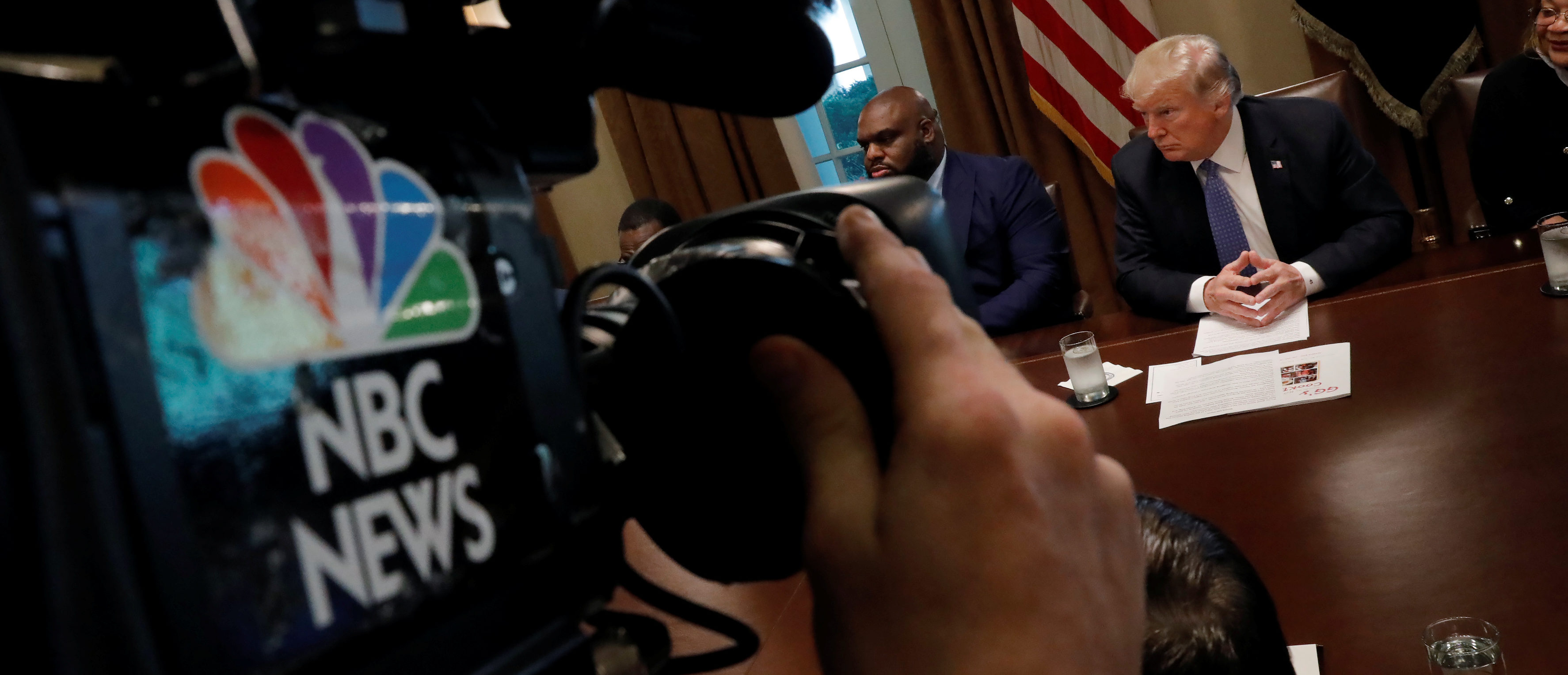 A NBC cameraman films a meeting between President Donald Trump and inner city pastors meeting with at the Cabinet Room of the White House in Washington D.C., August 1, 2018. REUTERS/Carlos Barria