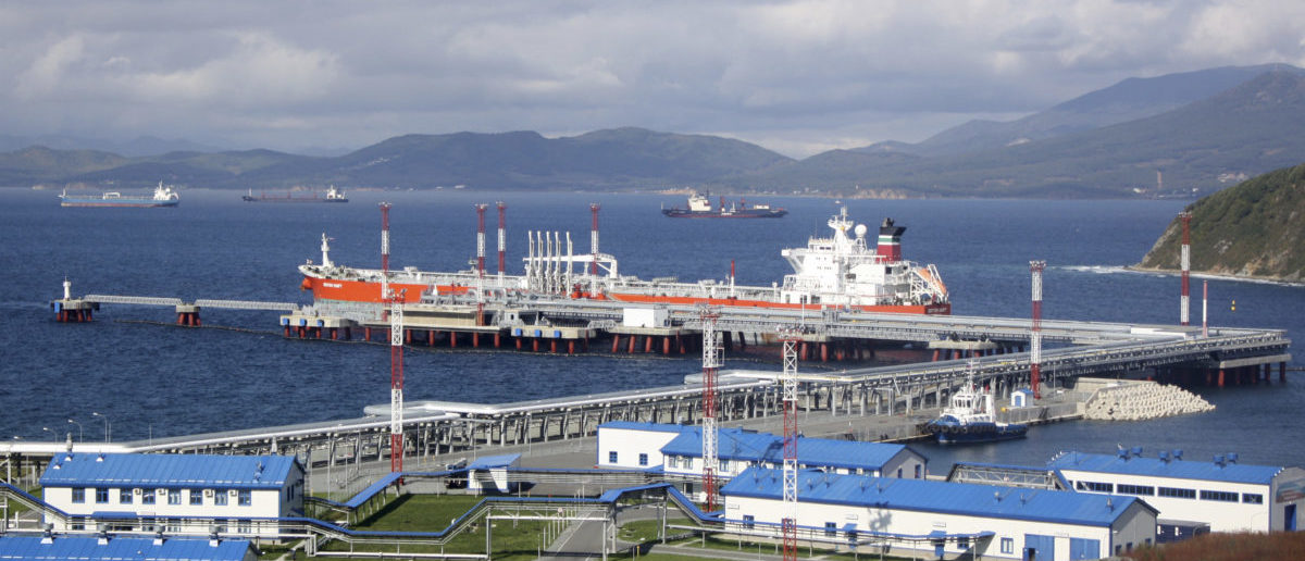 A general view shows the Kozmino oil-loading port in the bay of Kozmino, about 100 km (62 miles) east of Russia's city of Vladivostok, October 4, 2010. When the 4,070-km East Siberia-Pacific Ocean (ESPO) oil pipeline's second stage is finished in 2013, it will be the world's longest. At a cost of $25 billion, it dwarfs all other infrastructure projects in post-Soviet Russia. Transport data for December showed shippers paid 40 percent less per kilometre to ship a tonne of oil to the Pacific terminal at Kozmino than to Novorossiisk on the Black Sea. Picture taken October 4, 2010. To match feature RUSSIA-OIL/ASIA REUTERS/Jessica Bachman