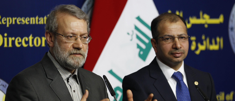 Iran's parliament speaker Ali Larijani (L) and Iraqi parliament speaker Salim al-Jabouri speak during a news conference in Baghdad December 24, 2014. REUTERS/Thaier Al-Sudani (IRAQ - Tags - Tags: POLITICS) - GM1EACO1HVU01