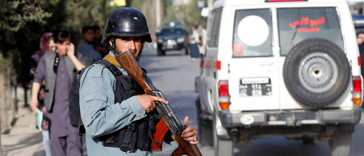 An Afghan policeman keeps watch near the site of a suicide bomb blast in Kabul, Afghanistan August 15, 2018. REUTERS/Omar Sobhani