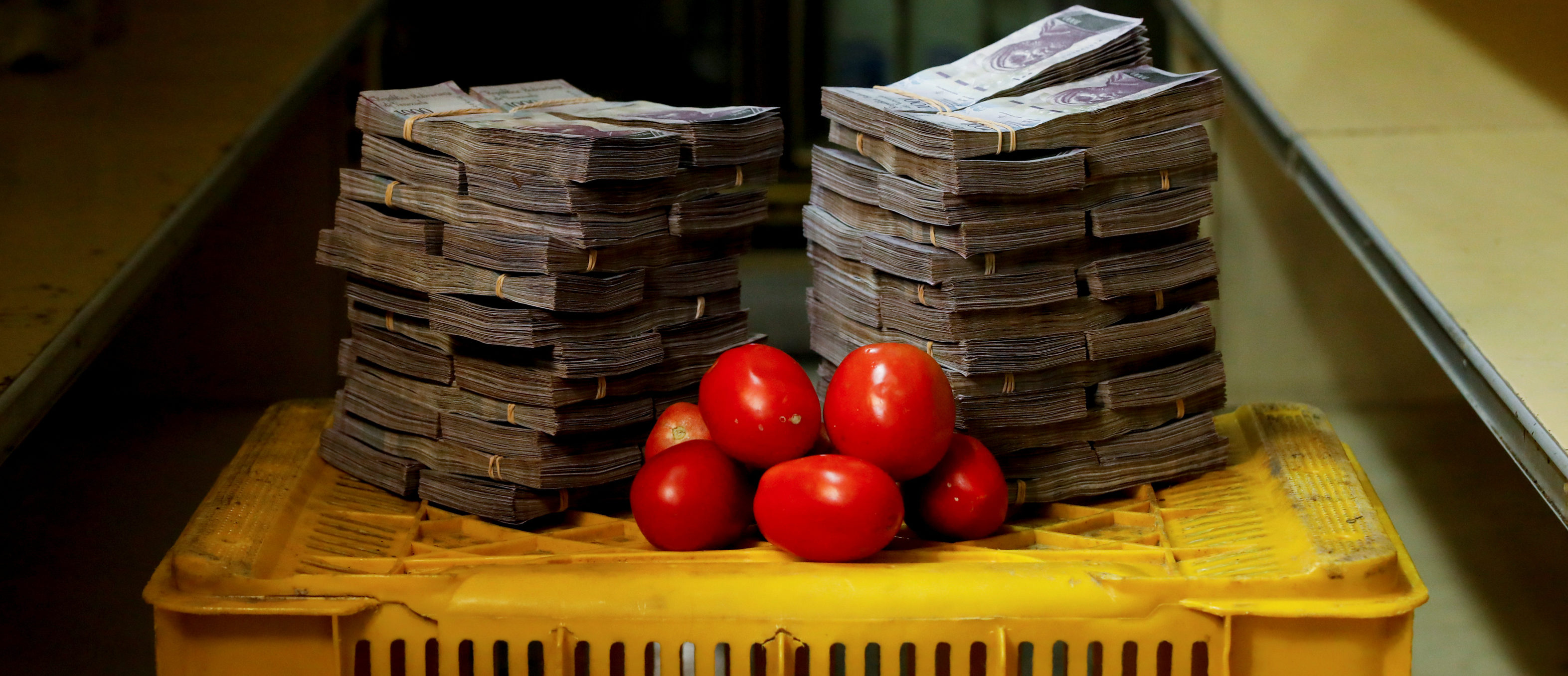 """A kilogram of tomatoes is pictured next to 5,000,000 bolivars, its price and the equivalent of 0.76 USD, at a mini-market in Caracas, Venezuela August 16, 2018. It was the going price at an informal market in the low-income neighborhood of Catia. REUTERS/Carlos Garcia Rawlins SEARCH """"GARCIA ECONOMY"""" FOR THIS STORY. SEARCH """"WIDER IMAGE"""" FOR ALL STORIES. - RC11990DC310"""