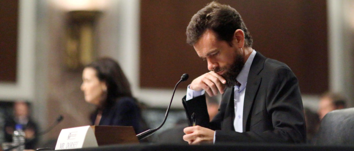 Twitter CEO Jack Dorsey takes notes as he testifies with Facebook COO Sheryl Sandberg at a Senate Intelligence Committee hearing on foreign influence operations on social media platforms on Capitol Hill in Washington, U.S., September 5, 2018. REUTERS/Jim Bourg