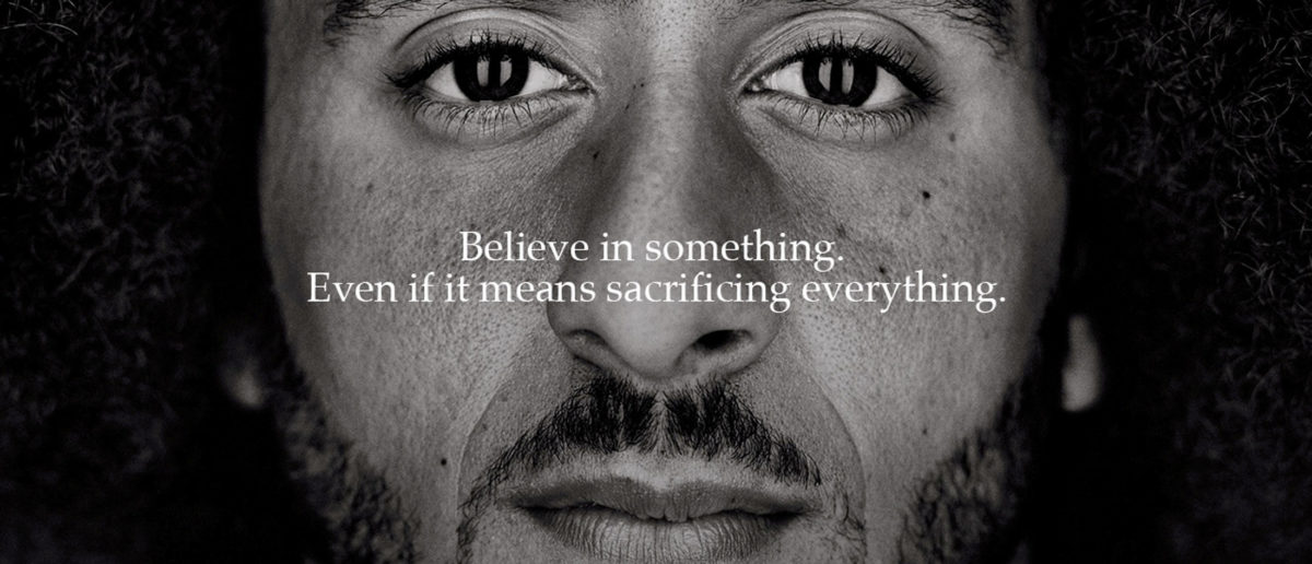 """FILE PHOTO: Former San Francisco quarterback Colin Kaepernick appears as a face of Nike Inc advertisement marking the 30th anniversary of its """"Just Do It"""" slogan in this image released by Nike in Beaverton, Oregon, U.S., September 4, 2018. Courtesy Nike/Handout via REUTERS/File Photo - RC12A08C7080"""