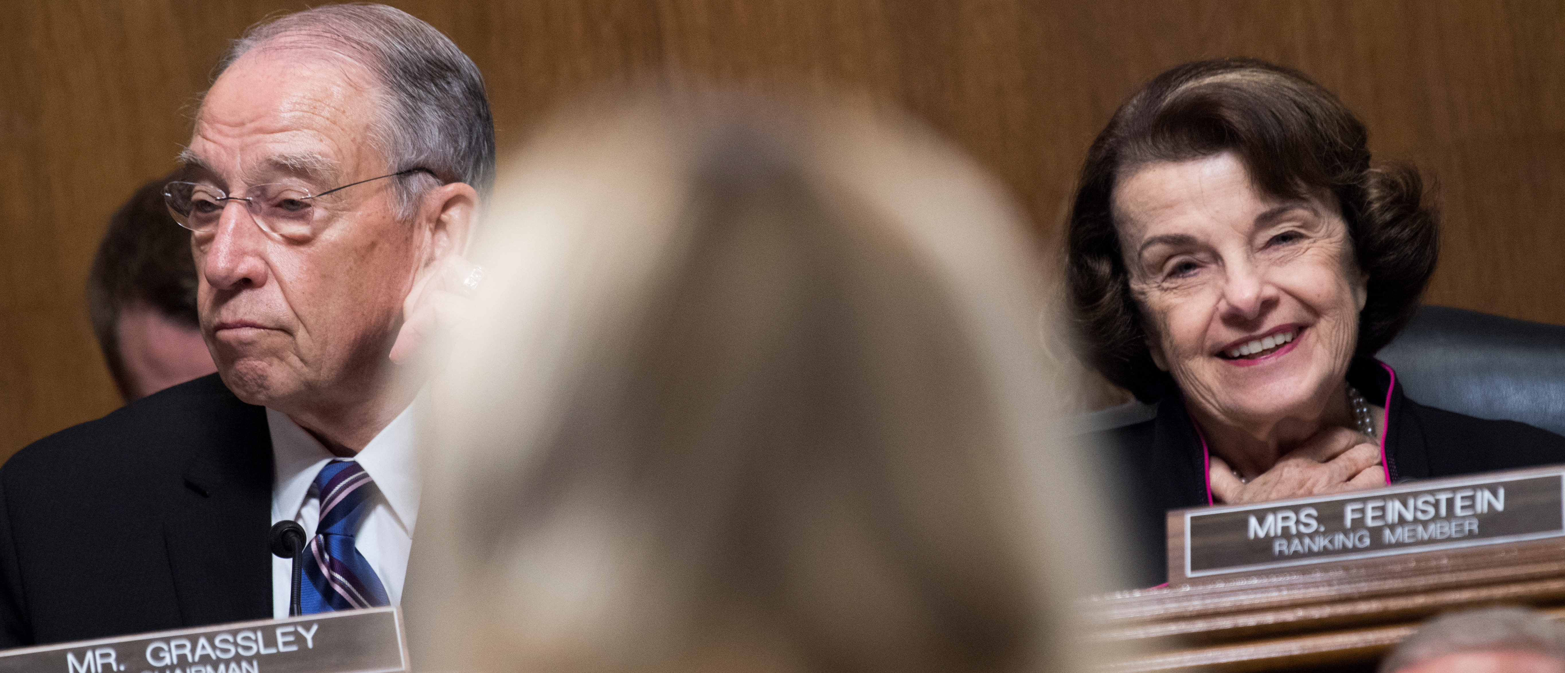 Chairman Charles Grassley, R-Iowa, and ranking member Sen. Dianne Feinstein, D-Calif., listen to Dr. Christine Blasey Ford testify during the Senate Judiciary Committee hearing on the nomination of Brett M. Kavanaugh to be an associate justice of the Supreme Court of the United States, focusing on allegations of sexual assault by Kavanaugh against Christine Blasey Ford in the early 1980s, in Washington, DC, U.S., September 27, 2018. Picture taken September 27, 2018. Tom Williams/Pool via REUTERS - RC17286589F0