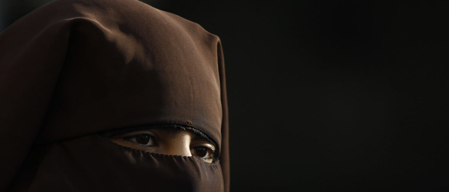 A muslim woman wearing a niqab attends a protest against islamophobia and racism organized by the Islamic Central Council of Switzerland (ICCS), in Bern October 29, 2011. REUTERS/Michael Buholzer