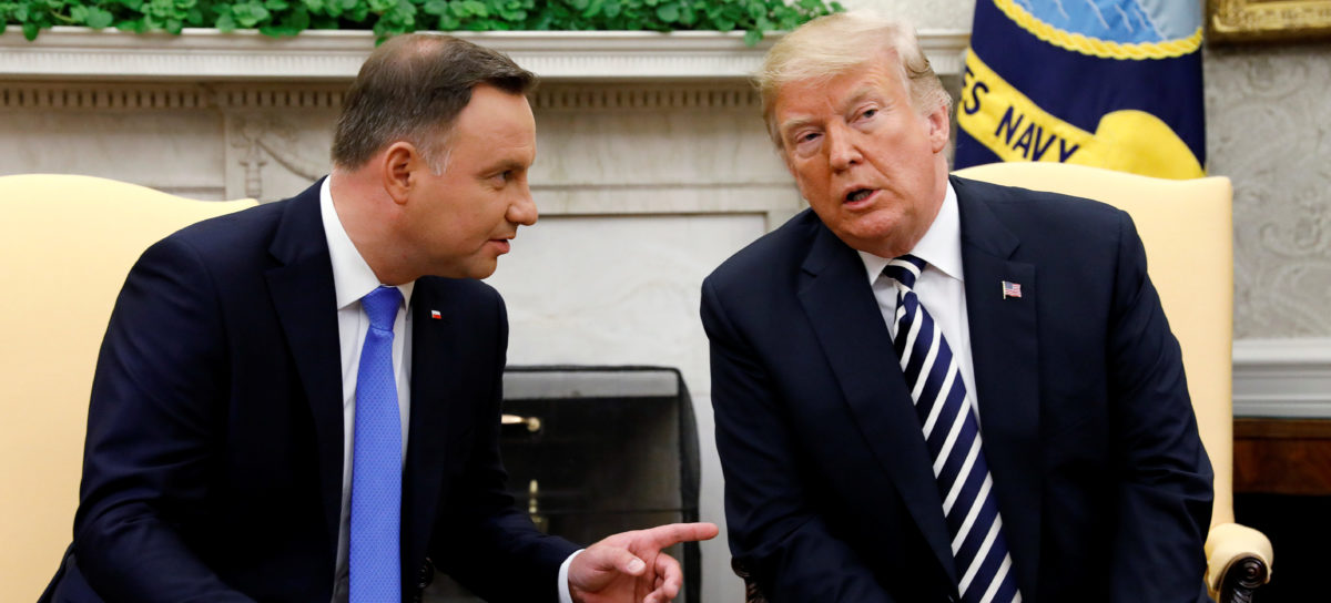 U.S. President Donald Trump listens during a meeting with Poland's President Andrzej Duda in the Oval Office of the White House in Washington, U.S., September 18, 2018. REUTERS/Kevin Lamarque