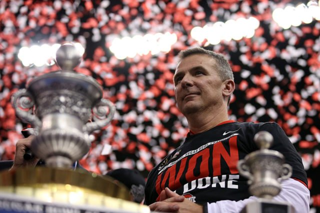NEW ORLEANS, LA - JANUARY 01: Head coach Urban Meyer of the Ohio State Buckeyes celebrates with the trophy after defeating the Alabama Crimson Tide in the All State Sugar Bowl at the Mercedes-Benz Superdome on January 1, 2015 in New Orleans, Louisiana. The Ohio State Buckeyes defeated the Alabama Crimson Tide 42 to 35. (Photo by Chris Graythen/Getty Images)