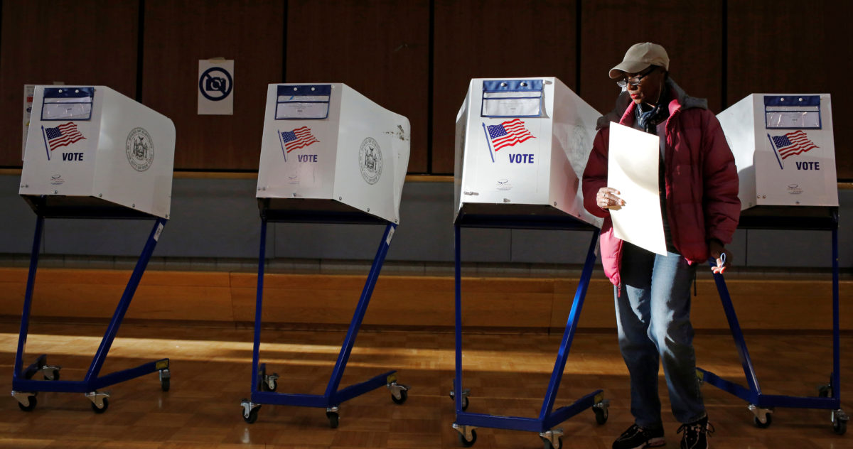 A woman exits the voting booth after filling out her ballot for the U.S presidential election at the James Weldon Johnson Community Center in the East Harlem neighbourhood of Manhattan, New York City, U.S. November 8, 2016. REUTERS/Andrew Kelly