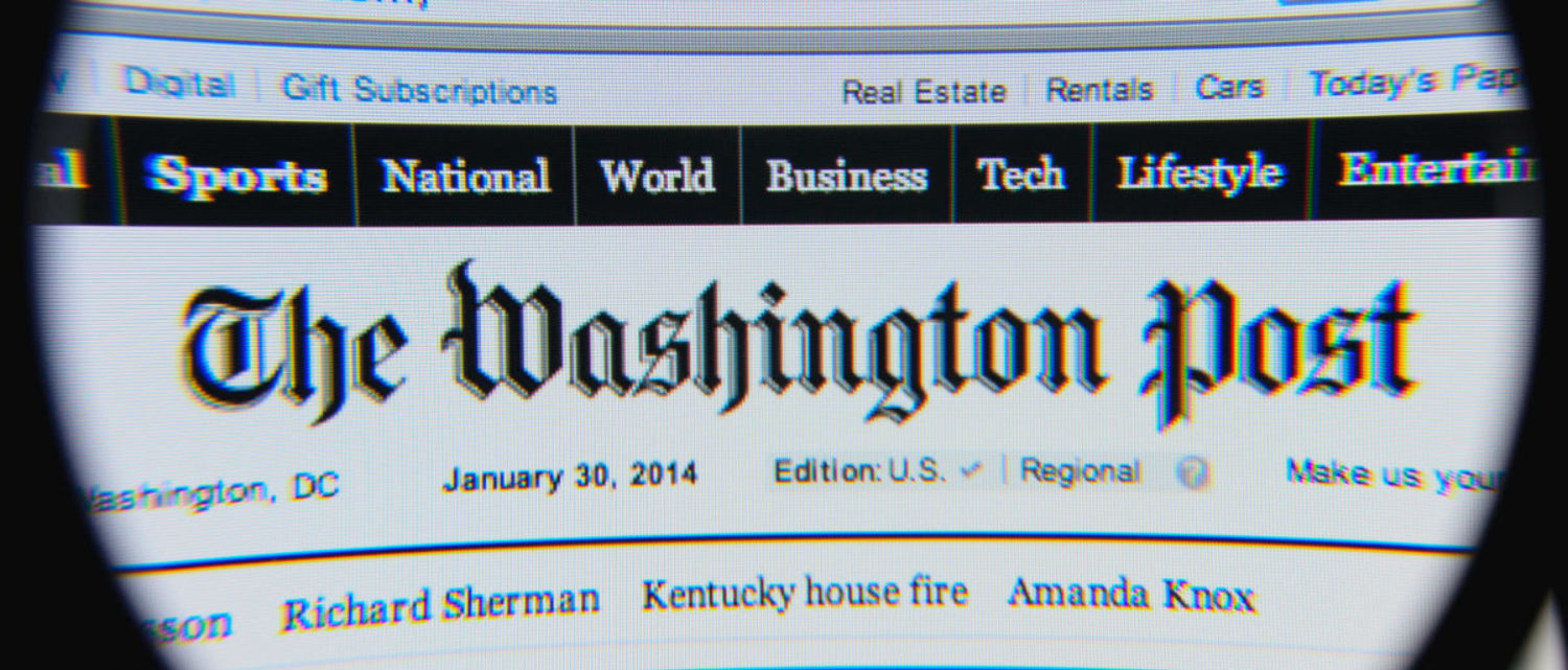 Pictured is The Washington Post homepage. (Gil C/Shutterstock)