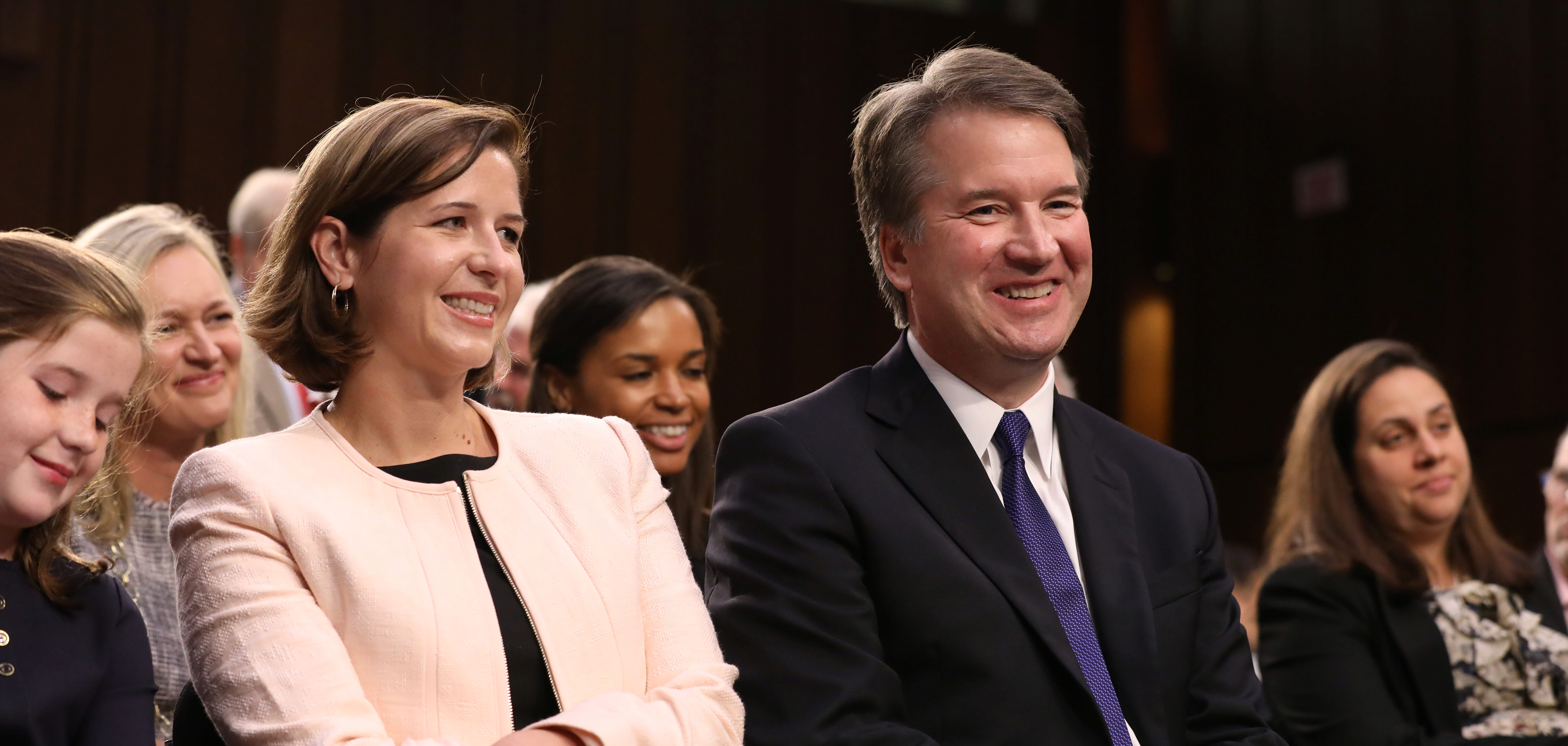 U.S. Supreme Court nominee judge Brett Kavanaugh sits with his wife Ashley Estes Kavanaugh as they listen to his introductions at his Senate Judiciary Committee confirmation hearing on Capitol Hill in Washington, U.S., September 4, 2018. REUTERS/Chris Wattie