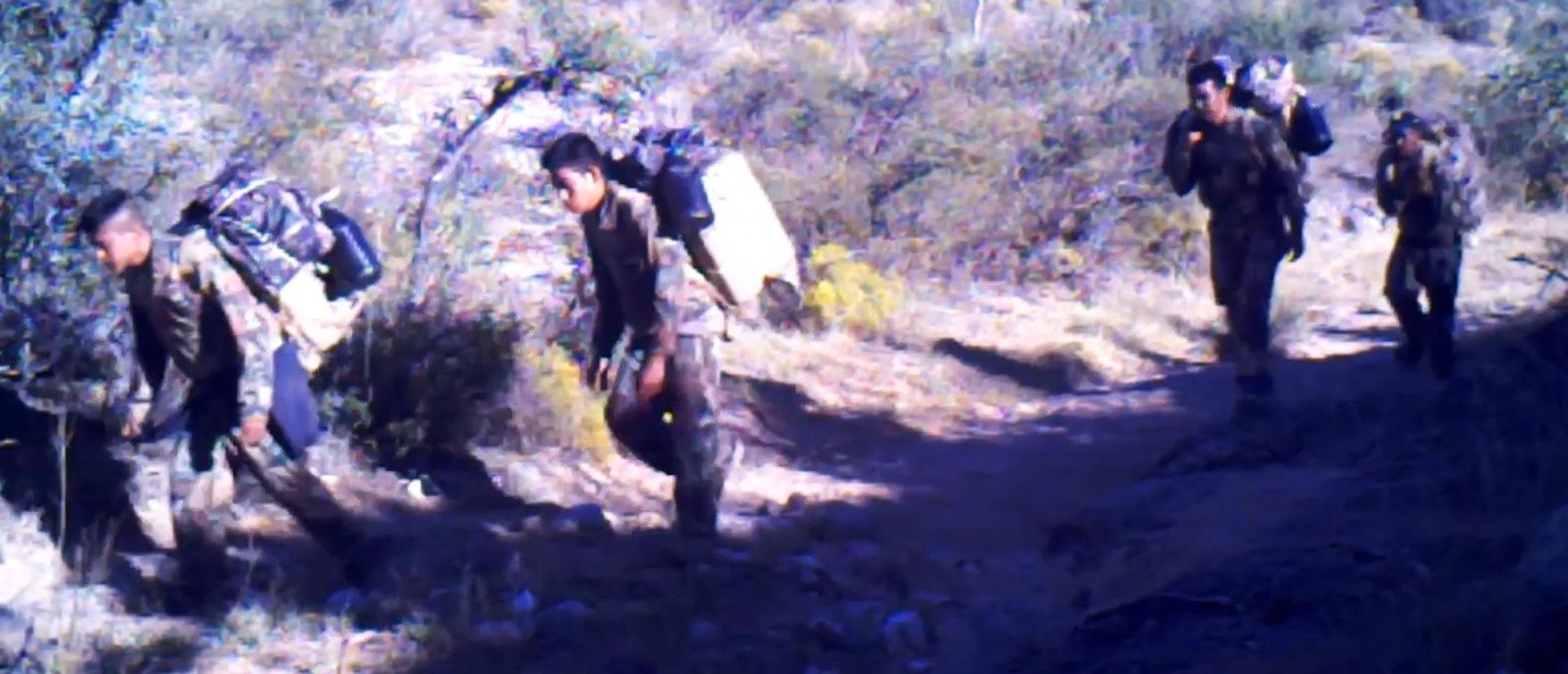 Surveillance video shows Mexican smugglers crossing through an Arizona ranch. Screenshot via YouTube/TheDC Shorts