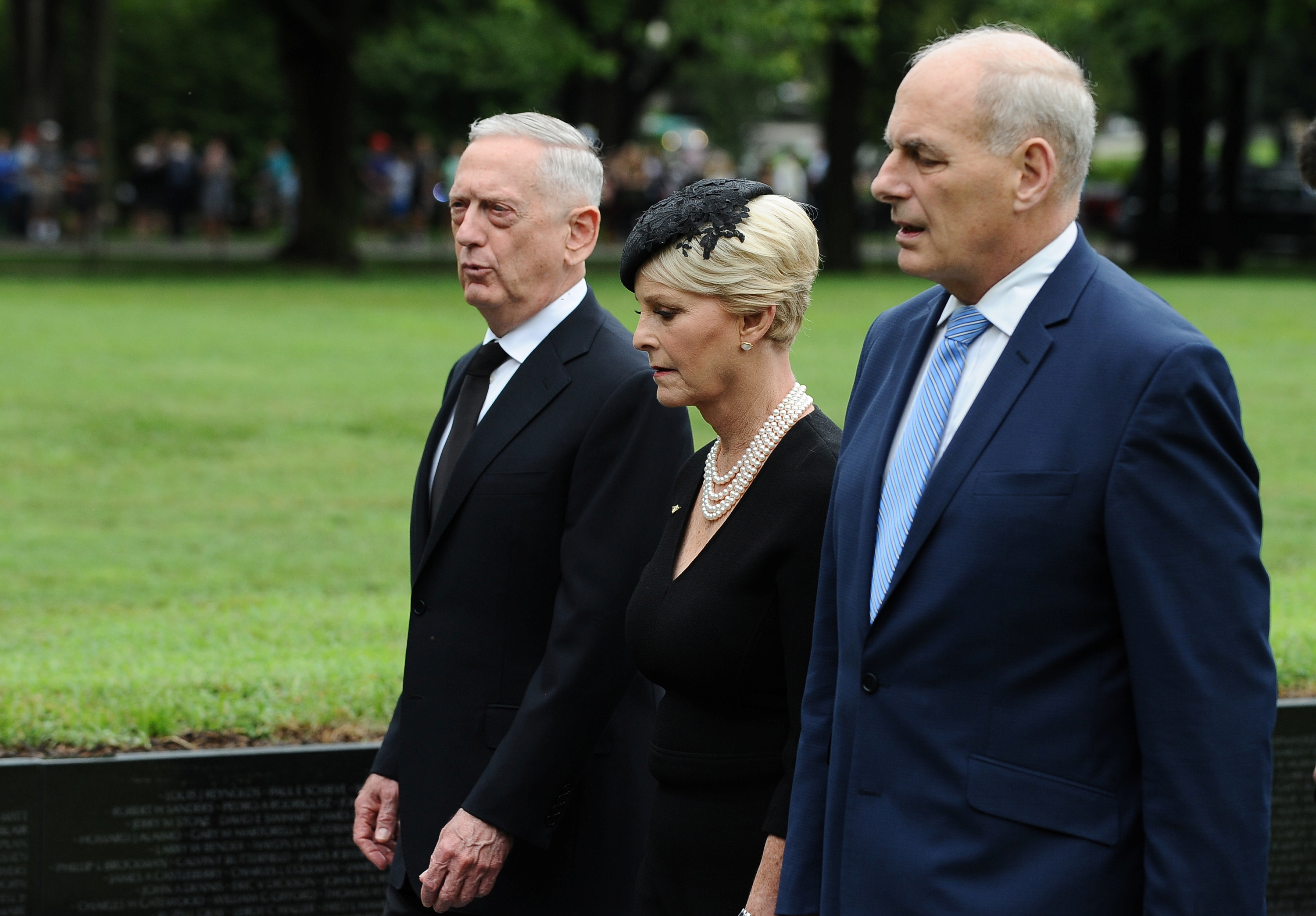 U.S. Secretary of Defense James Mattis, General John Kelly, White House Chief of Staff and Cindy McCain, wife of late Senator John McCain, depart after laying a ceremonial wreath honoring all whose lives were lost during the Vietnam War at the Vietnam Veterans Memorial in Washington, U.S., September 1, 2018. REUTERS/Mary F. Calvert