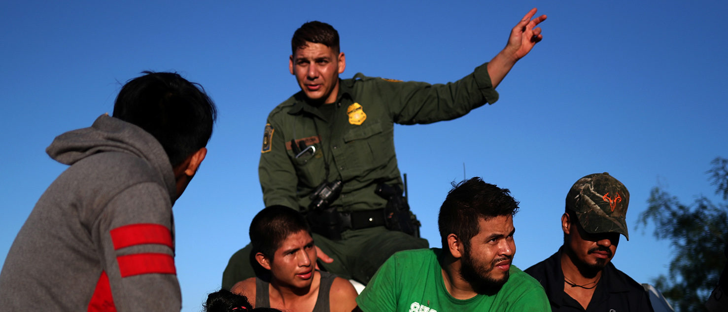 Men and a woman are transported in the back of a truck after they were apprehended by the Border Patrol in Falfurrias, Texas for illegally crossing into the U.S. border from Mexico on August 30, 2018. REUTERS/Adrees Latif