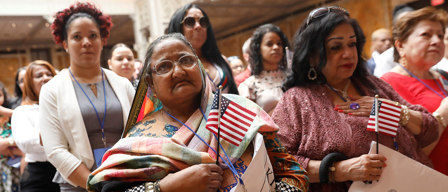 New citizens stand during a U.S. Citizenship and Immigration Services (USCIS) naturalization ceremony at the New York Public Library in Manhattan, New York, U.S., July 3, 2018. REUTERS/Shannon Stapleton