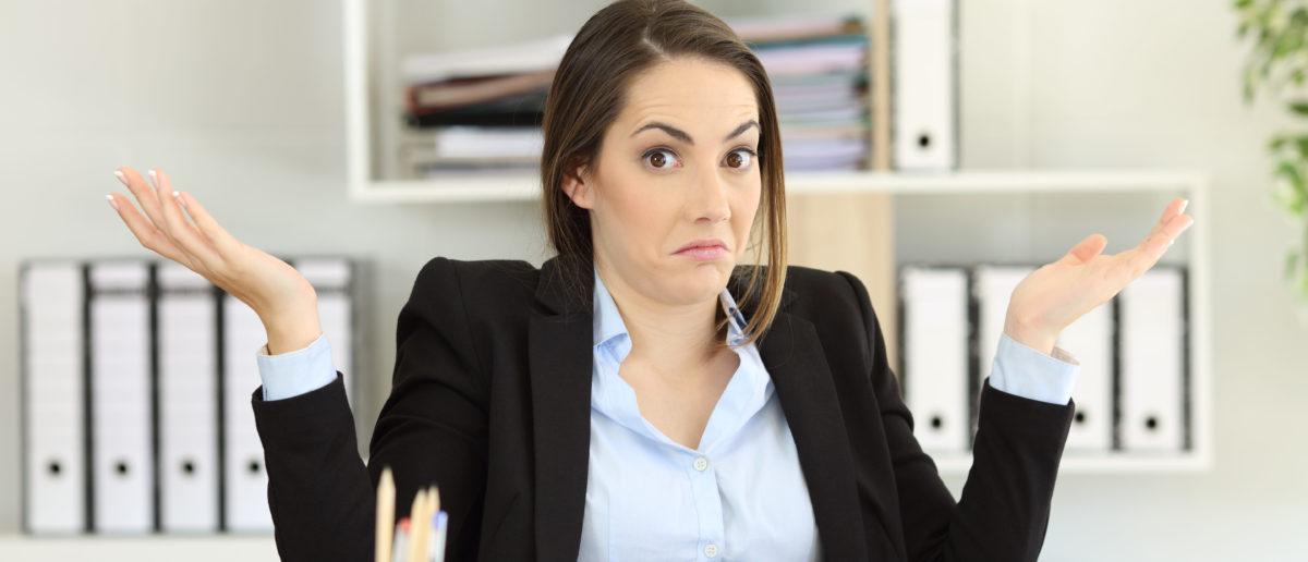 An executive shrugs her shoulders. Shutterstock image via user Antonio Guillem