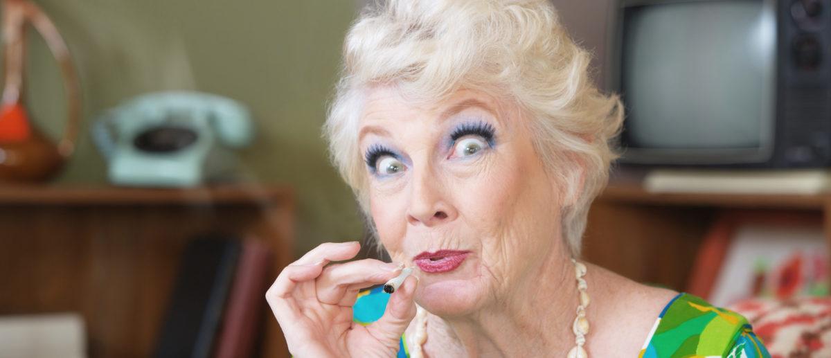 A senior citizen smokes marijuana. Shutterstock image via user Creatista