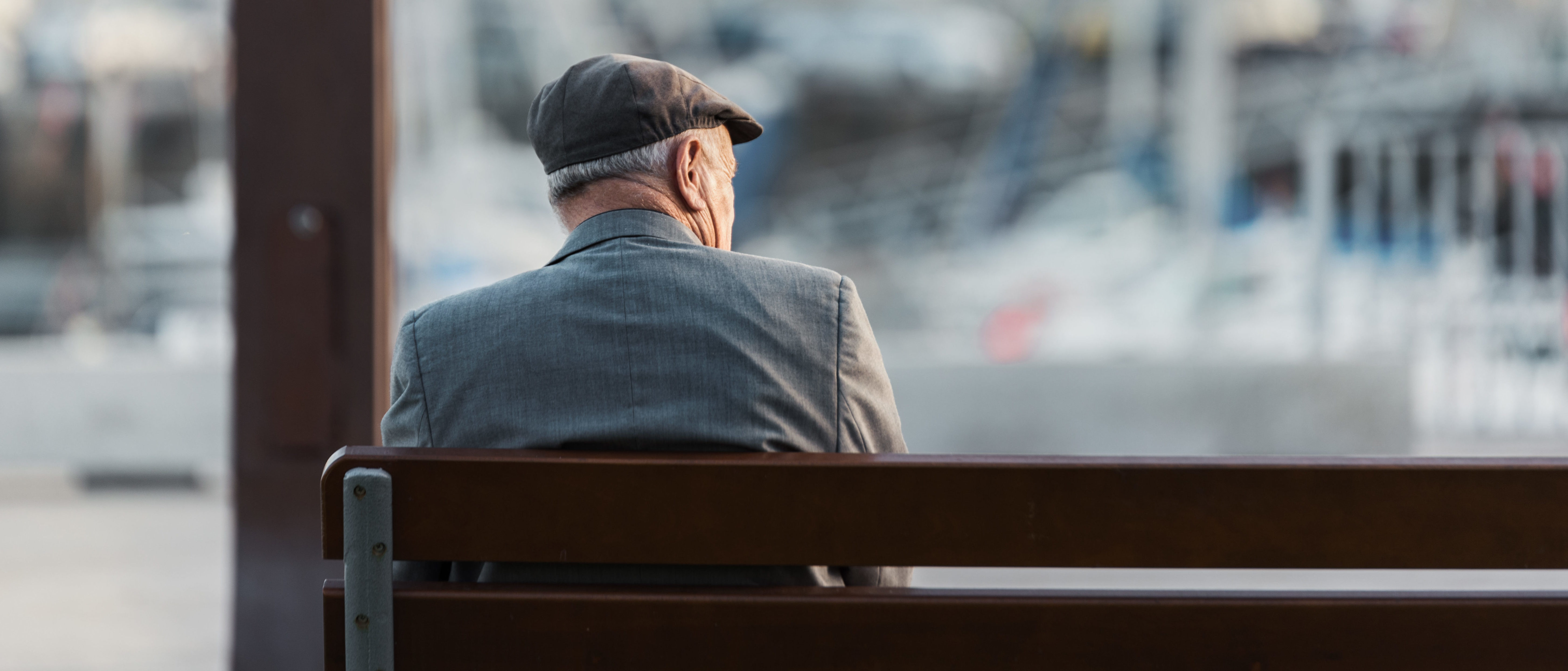 Old man sitting on a bench (By Eduardo Regueiro/Shutterstock)