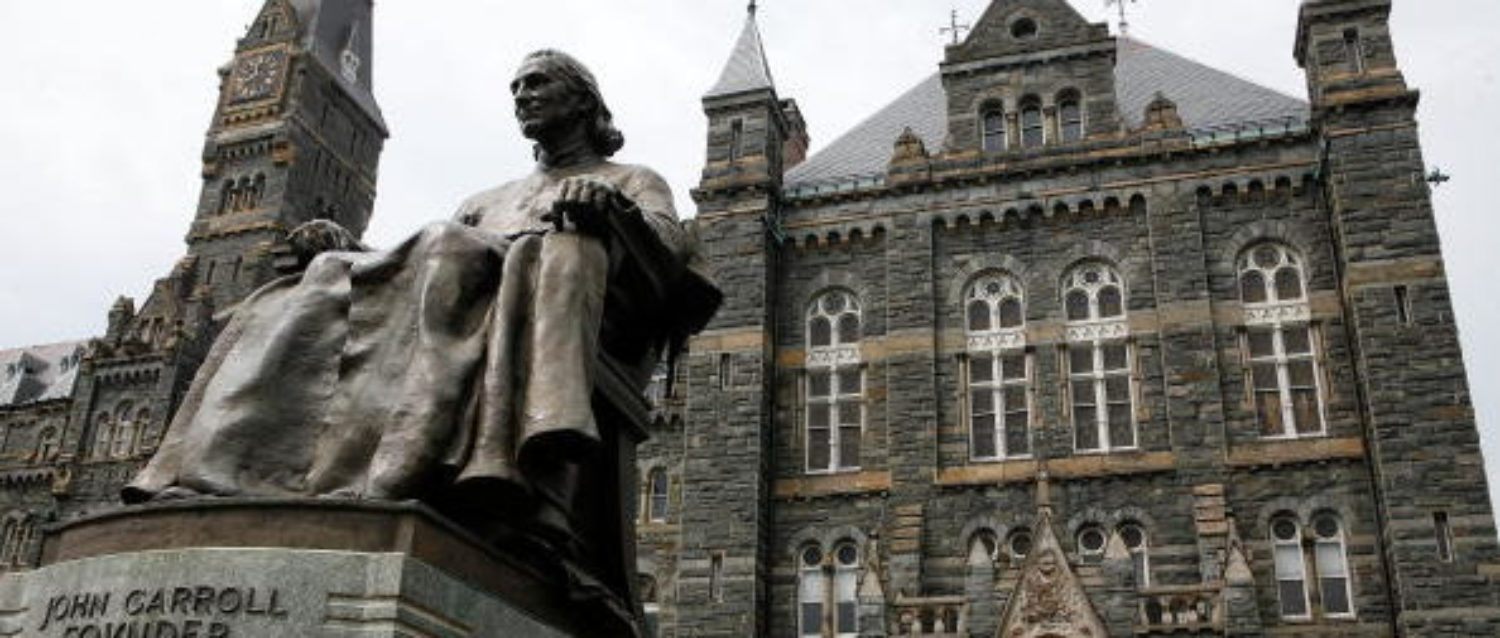 WASHINGTON - AUGUST 15: A statue of John Carroll, founder of Georgetown University, sits before Healy Hall on the school's campus August 15, 2006 in Washington, DC. Georgetown University was founded in 1789 and it is the oldest Catholic and Jesuit university in the U.S. (Photo by Alex Wong/Getty Images)