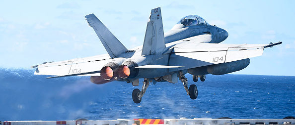 TOWNSVILLE, AUSTRALIA - JULY 14: A US Navy Super Hornet takes off from the deck of the USS Ronald Reagan on July 14, 2017 in Townsville, Australia. USS Ronald Reagan is a 1,092- foot aircraft carrier which carries a crew of 4,539 around 60 aircraft. Exercise Talisman Sabre is the largest combined military exercise undertaken in Australia. The biennial exercise is the principal Australian and U.S. military training activity. (Photo by Ian Hitchcock/Getty Images)