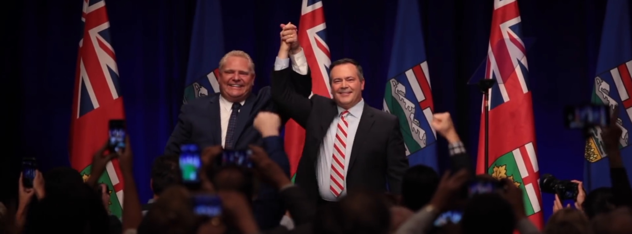 Ontario Premier Doug Ford (L) and Alberta's United Conservative Party leader Jason Kenney show their solidarity in opposing Canadian Prime Minister Justin Trudeau's carbon tax. YouTube screenshot, Oct. 6, 2018.
