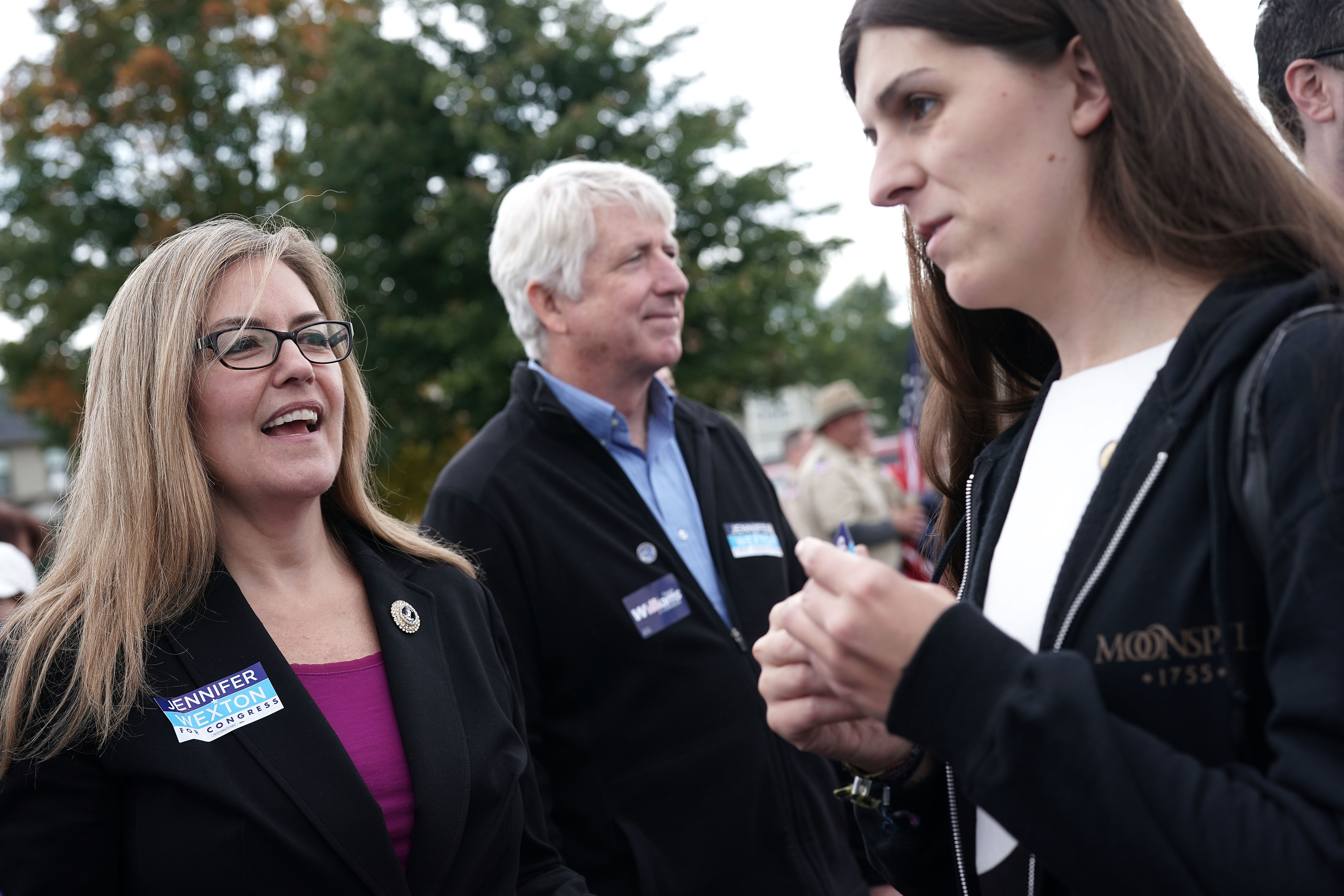 HAYMARKET, VA - OCTOBER 20: (L-R) Democratic U.S. House candidate and Virginia State Sen. Jennifer Wexton (D-33rd District), Virginia State Attorney General Mark Herring (C), and Virginia State Delegate Danica Roem (D-13th District) participate in the annual Haymarket Day parade October 20, 2018 in Haymarket, Virginia. Wexton is challenging incumbent Rep. Barbara Comstock (R-VA) for the House seat that has been in Republican hands since 1981. Wexton is currently leading Comstock in the polls. (Photo by Alex Wong/Getty Images)