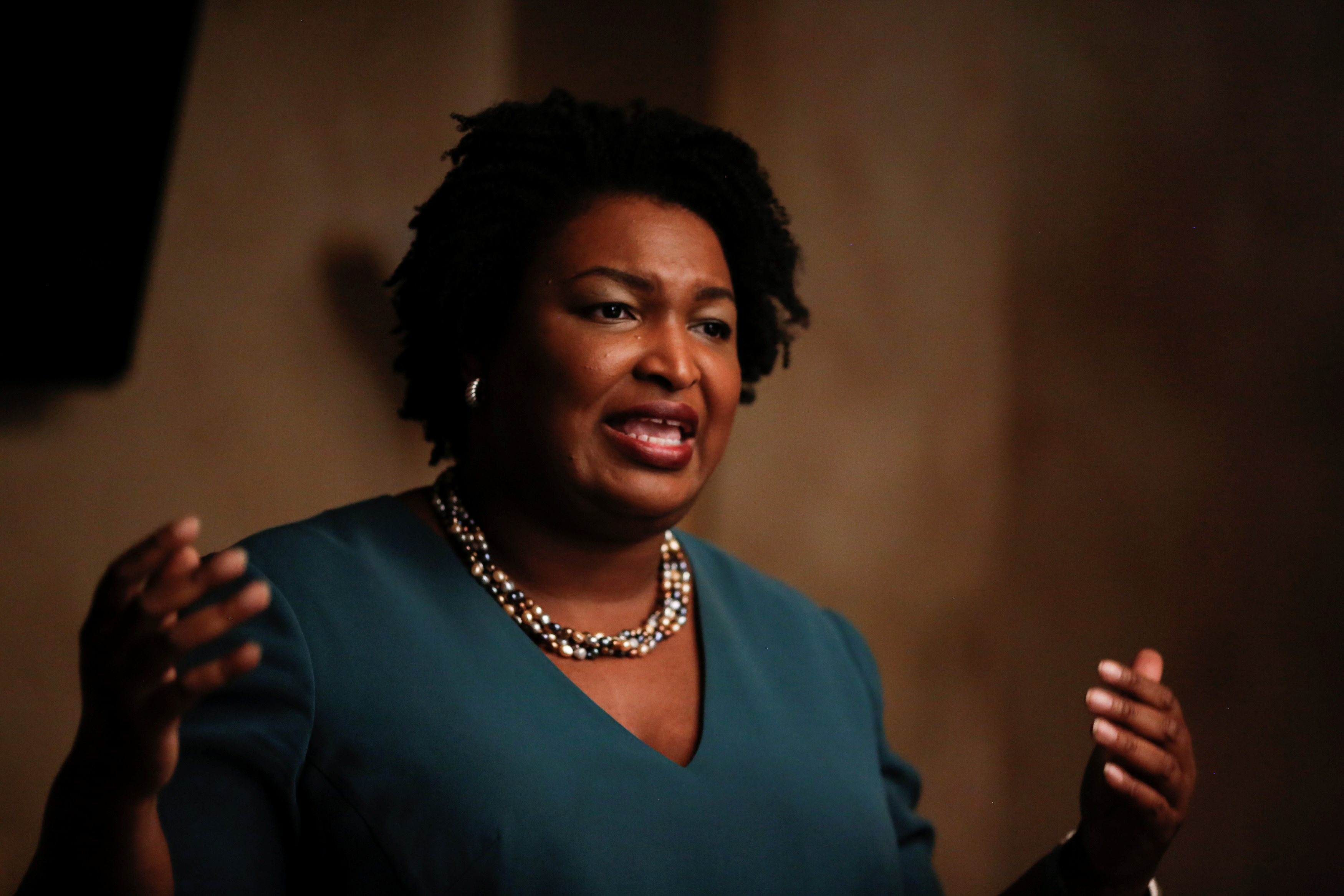 Stacey Abrams speaks at a Young Democrats of Cobb County meeting as she campaigns in Cobb County