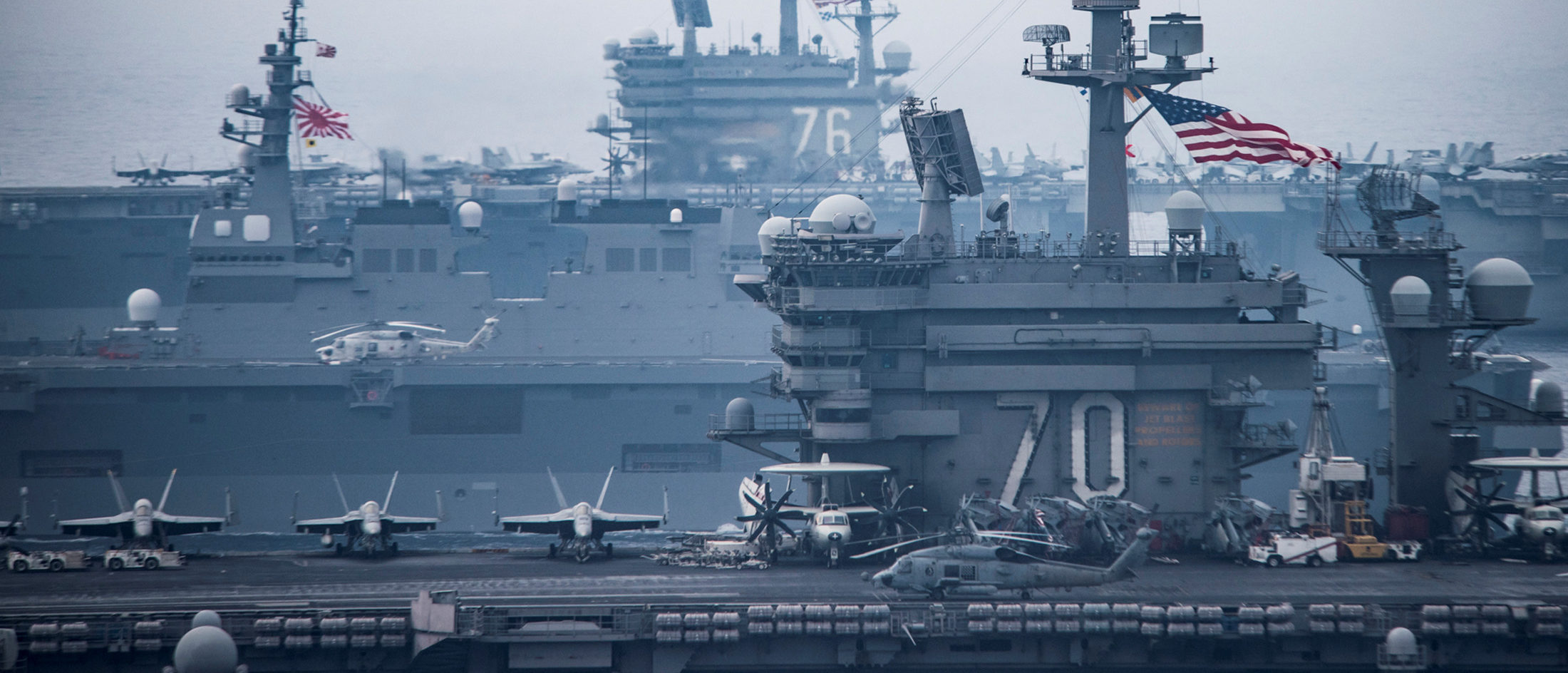 U.S. Navy aircraft carriers USS Carl Vinson (R) and USS Ronald Reagan sail with their strike groups and Japanese naval ships during training in the Sea of Japan, June 1, 2017. U.S. Navy/Mass Communication Specialist 2nd Class Z.A. Landers/Handout via REUTERS