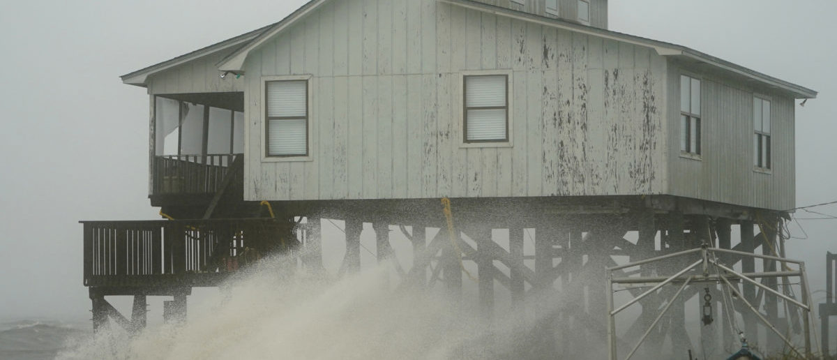 Waves take over a house as Hurricane Michael comes ashore in Alligator Point, Florida, U.S., October 10, 2018. REUTERS/Carlo Allegri