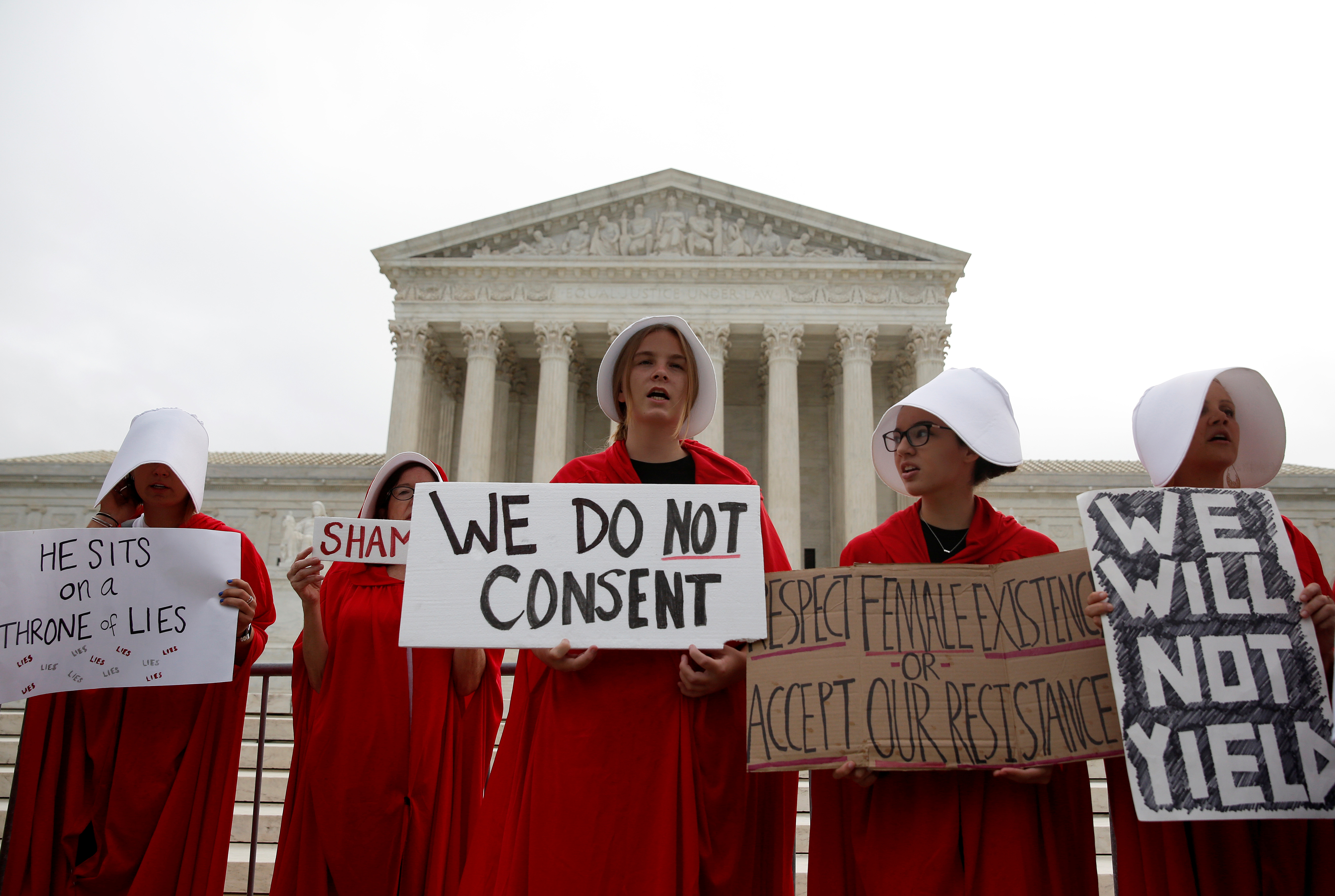 Protesters demonstrate on first day with newly sworn in Associate Justice Brett Kavanaugh on the court at the Supreme Court in Washington, U.S., October 9, 2018. REUTERS/Joshua Roberts