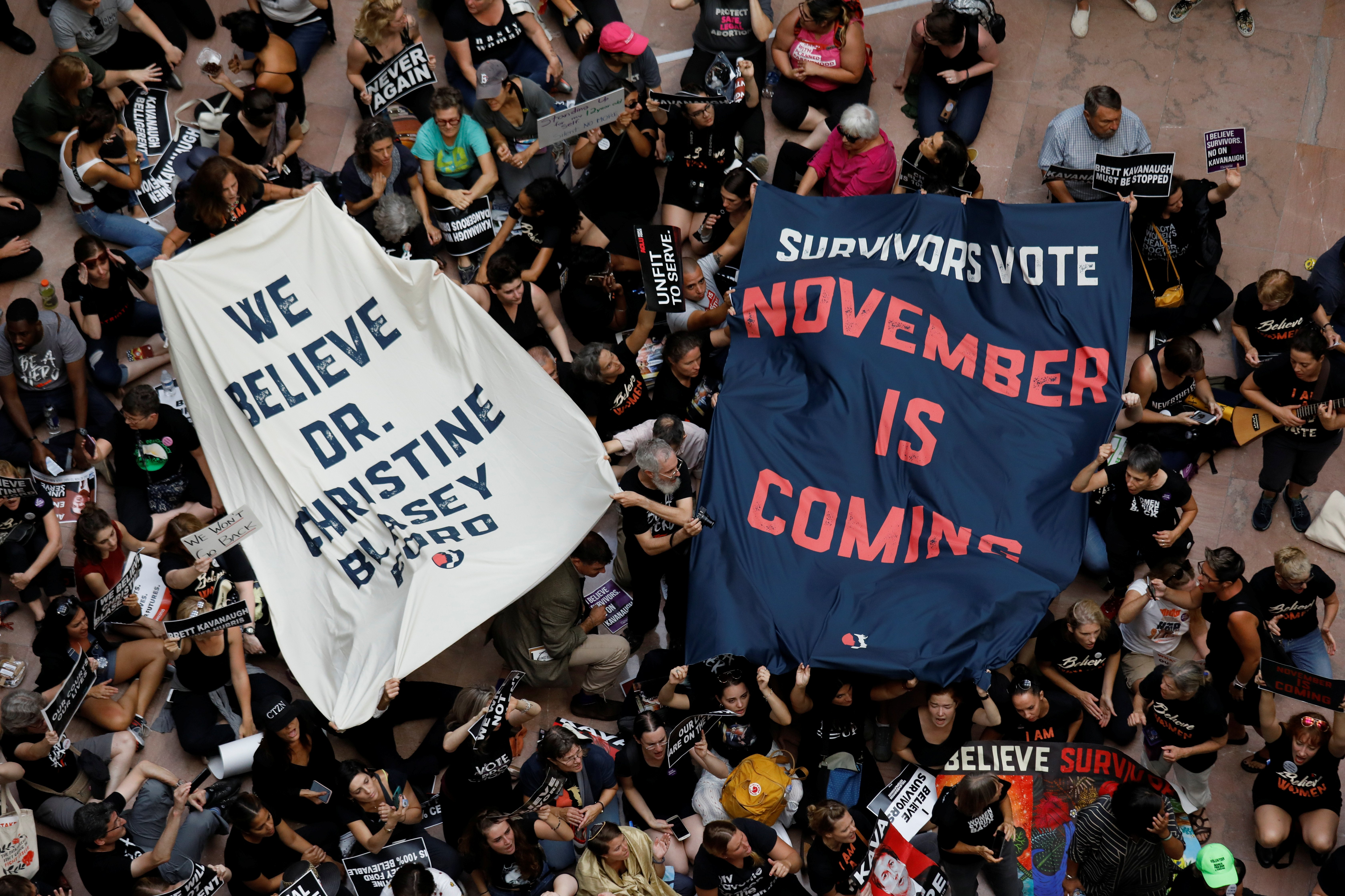 Activists rally inside the Senate Hart Office Building during a protest in opposition to U.S. Supreme Court nominee Brett Kavanaugh on Capitol Hill in Washington, U.S., October 4, 2018. REUTERS/Kevin Lamarque