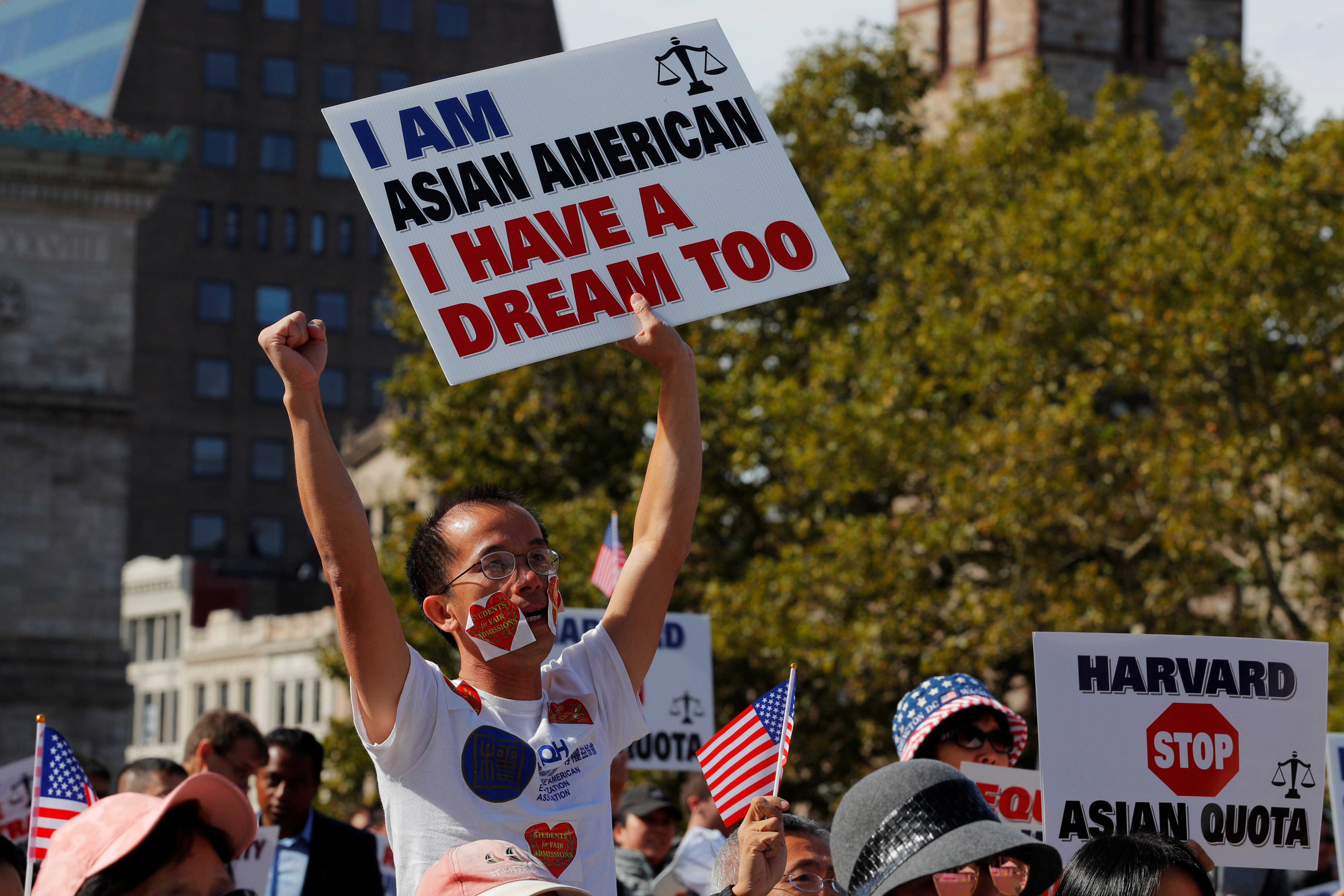 "Supporters attend the ""Rally for the American Dream - Equal Education Rights for All,"" ahead of the start of the trial in a lawsuit accusing Harvard University of discriminating against Asian-American applicants, in Boston, Massachusetts, U.S., October 14, 2018. REUTERS/Brian Snyder"