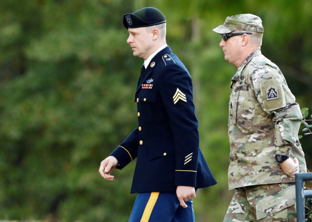 "U.S. Army Sergeant Beaudry Robert ""Bowe"" Bergdahl (L) is escorted to the courthouse for the fifth day of sentencing proceedings in his court martial at Fort Bragg, North Carolina, U.S., October 31, 2017. REUTERS/Jonathan Drake"