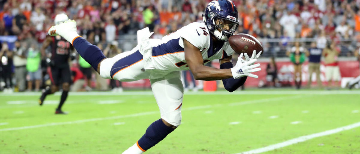 GLENDALE, AZ - OCTOBER 18: Wide receiver Courtland Sutton #14 of the Denver Broncos scores a 28-yard touchdown during the first quarter against the Arizona Cardinals at State Farm Stadium on October 18, 2018 in Glendale, Arizona. (Photo by Christian Petersen/Getty Images)