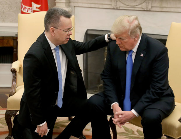 WASHINGTON, DC - OCTOBER 13: U.S. President Donald Trump and American evangelical Christian preacher Andrew Brunson (L) participate in a prayer in the Oval Office a day after Brunson was released from a Turkish jail, at the White House on October 13, 2018 in Washington, DC. Brunson was detained for two years in Turkey on espionage and terrorism-related charges that the pastor said were false. (Photo by Mark Wilson/Getty Images)