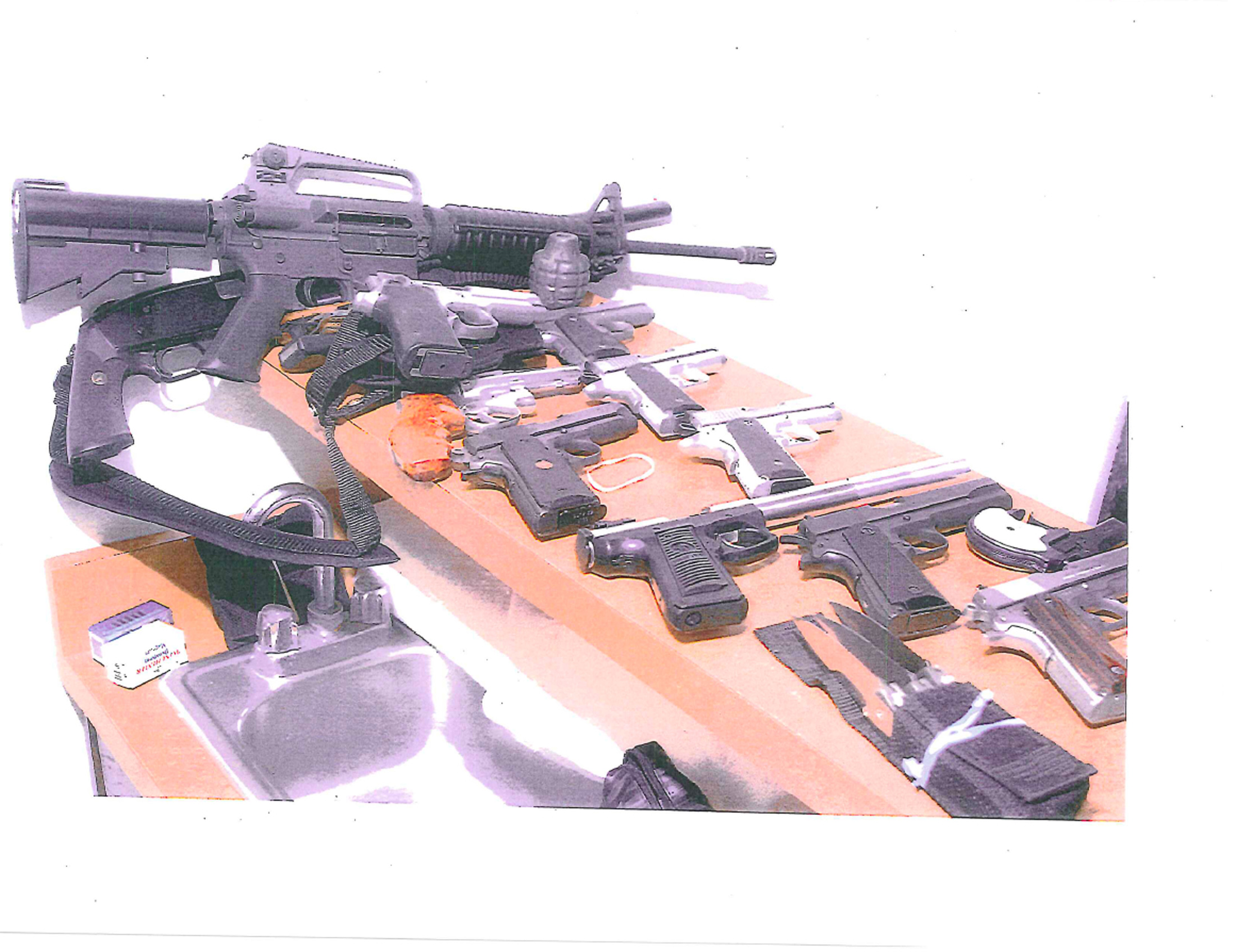 A handout photo by the U.S. Department of Justice released to Reuters on July 14, 2011 shows various weapons seized from Whitey Bulger's apartment in Santa Monica, California, following his arrest in June. A cache of weapons including a number of handguns, an assault rifle and a sawed-off shotgun, and bundles of cash were found during the search. Former crime boss Bulger entered a plea of not guilty in his arraignment on July 6, 2011 on federal racketeering charges, including 19 alleged murders from the 1970s and 1980s. REUTERS/U.S. Department of Justice/Handout