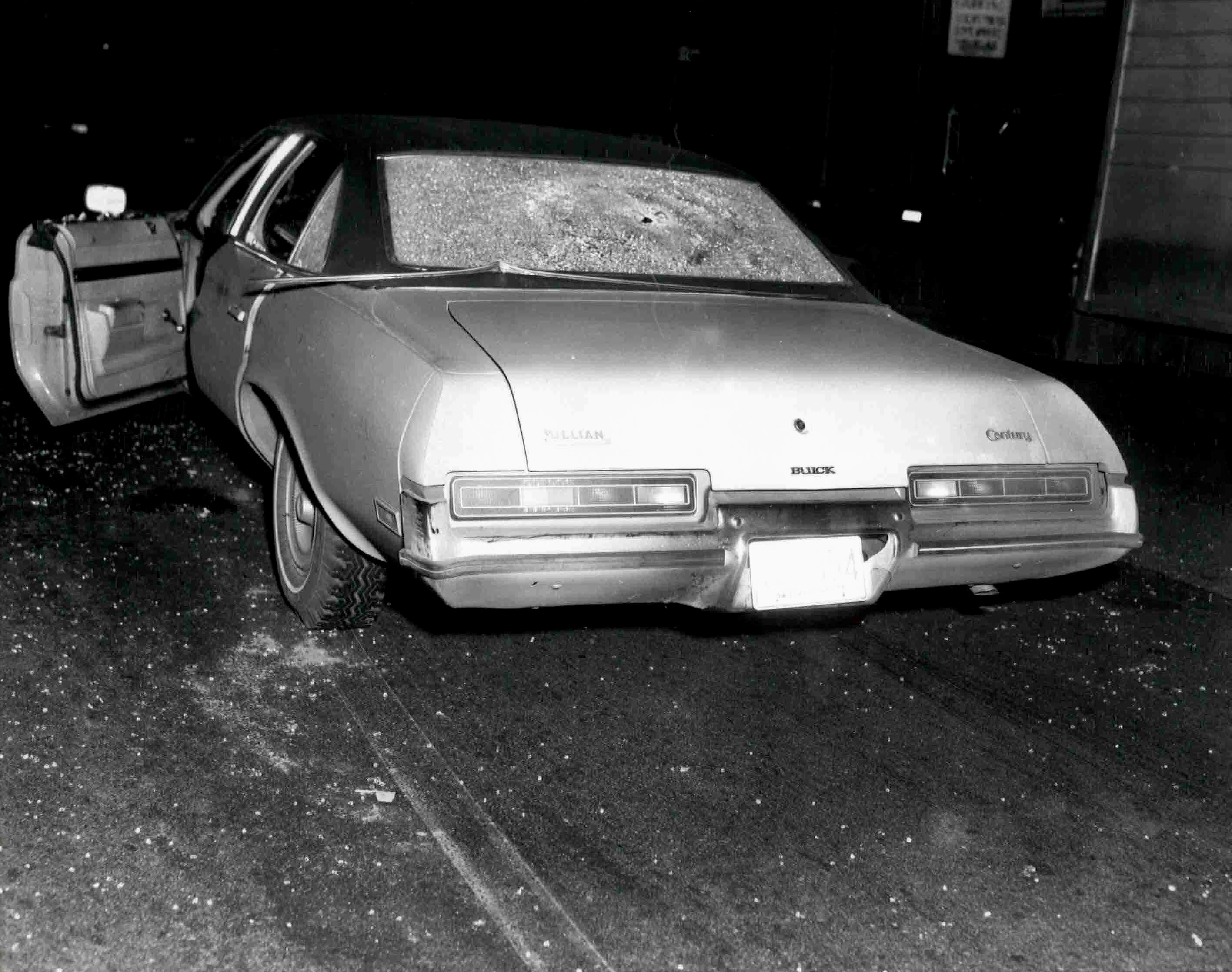 """FILE PHOTO: A vehicle with bullet holes and broken glass which was shown to jurors hearing the racketeering and murder trial of accused Boston mob boss James """"Whitey"""" Bulger is seen in this undated handout photo provided by the U.S. Attorney's Office June 17, 2013. U.S. Attorney's Office/Handout/File Photo via REUTERS."""