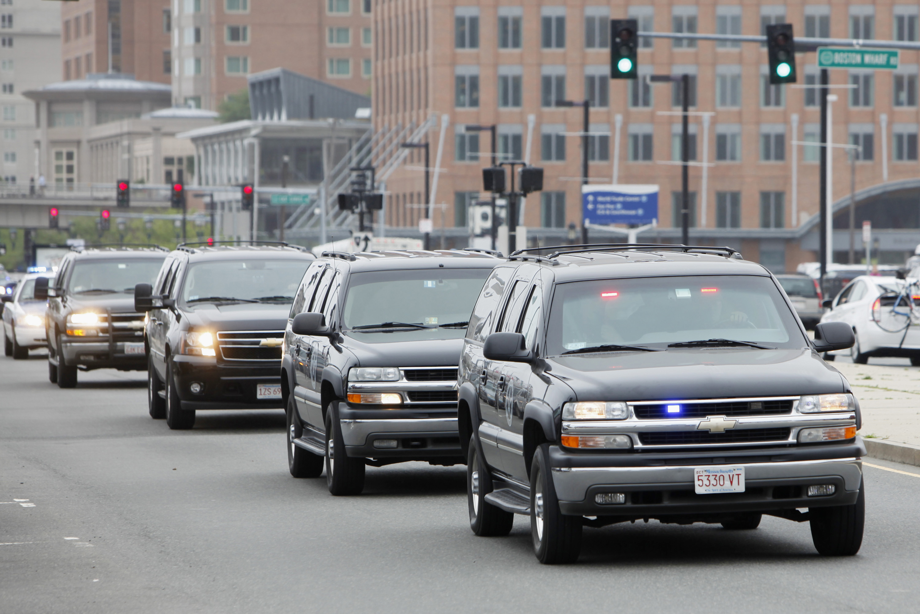 """A motorcade transports James """"Whitey"""" Bulger and federal officials through South Boston, Massachusetts June 24, 2011. Former mob boss James """"Whitey"""" Bulger, captured near his coastal California hideout after 16 years on the run, was ordered held without bond on Thursday for transfer back to Boston to face charges of murder, extortion and conspiracy. Bulger, 81, one of America's most wanted fugitives, was lured from his Santa Monica, California, apartment just blocks from the Pacific on Wednesday evening by federal agents and police acting on a tip from the public. REUTERS/Greg M Cooper"""