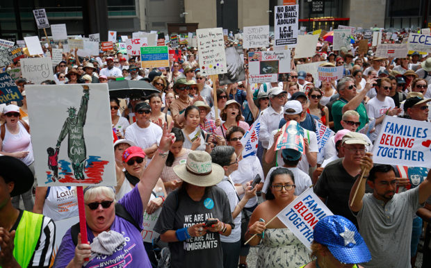 Protestors gather for a demonstration against the US immigration policies separating migrant families in Chicago, June 30, 2018. - Demonstrations are being held across the US on Saturday, June 30, 2018 against President Donald Trump's hardline immigration policy. JIM YOUNG/AFP/Getty Images