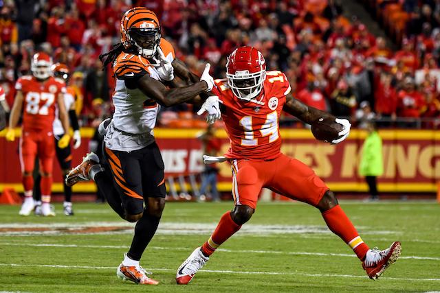 Sammy Watkins #14 of the Kansas City Chiefs stiff arms Dre Kirkpatrick #27 of the Cincinnati Bengals during the first half of the game at Arrowhead Stadium on October 21, 2018 in Kansas City, Kansas. (Photo by Peter Aiken/Getty Images)